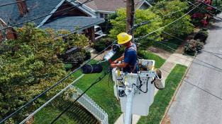 Electrician Lafayette team member servicing power lines for electrical service in Lafayette, LA